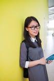 一个年轻亚洲女学生的画象在大学 图库摄影