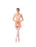 一个年轻人和适合女性跳芭蕾舞者在橙色礼服 库存照片