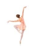一个年轻人和适合女性跳芭蕾舞者在橙色礼服 库存图片