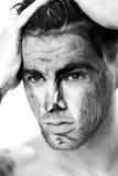 一个年轻人的黑白画象有油漆条纹的在面孔的 构成幻想艺术  免版税库存图片