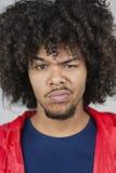 一个年轻人的画象有被抬的眼眉的 免版税图库摄影