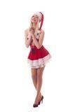 一个年轻可爱的性感的圣诞老人女孩的画象 图库摄影