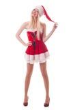一个年轻可爱的性感的圣诞老人女孩的画象 免版税图库摄影