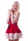 一个年轻可爱的性感的圣诞老人女孩的画象 免版税库存照片