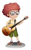 一个年轻吉他弹奏者 库存照片