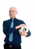 一个年轻商人的画象与足球的 图库摄影