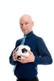 一个年轻商人的画象与足球的 免版税库存照片