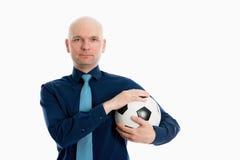 一个年轻商人的画象与足球的 库存照片