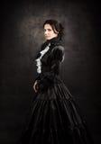 一个维多利亚女王时代的夫人的风格化画象黑色的 免版税库存图片