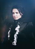 一个维多利亚女王时代的夫人的风格化画象黑色的 库存照片