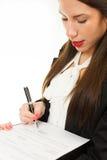 一个年轻女商人的画象,签署的合同 免版税图库摄影