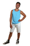 一个年轻微笑的人的整体画象肌肉衬衣的 免版税库存图片
