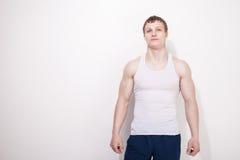 一个年轻性感的肌肉人的画象内衣的 库存照片