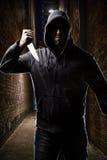 一个黑暗的胡同的窃贼 库存照片