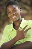 一个年轻海地的青少年的男孩的画象 免版税图库摄影