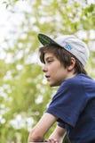一个年轻男孩的档案有basecap的  免版税库存照片