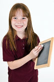 在粉笔板的年轻学校女孩文字 免版税图库摄影