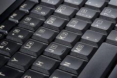 从一个黑笔记本的Keybord 免版税库存图片