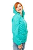 一个年轻美丽的女孩的画象一件夹克的有敞篷isola的 库存图片