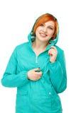 一个年轻美丽的女孩的画象一件夹克的有敞篷isola的 图库摄影