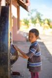一个年轻老挝男孩的画象在农村老挝 免版税图库摄影