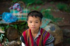 一个年轻老挝男孩的画象在农村老挝 免版税库存照片