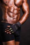 一个年轻肌肉人的播种的图象 免版税库存照片