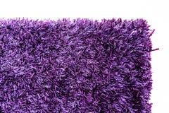 一个紫色地毯角落的纹理 免版税库存图片