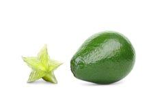 一个绿色阳桃和鲕梨 在白色背景的美丽的热带水果 r 库存图片