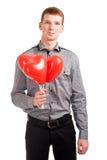一个年轻人的纵向有气球的 库存图片