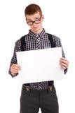 一个年轻人的纵向有空白董事会的 免版税库存图片