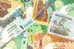 一些卡达里亚尔钞票背景 库存图片