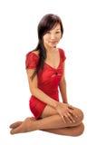 一件红色礼服的东部女孩 免版税库存图片
