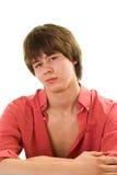 一件红色衬衣的美丽的少年 免版税图库摄影