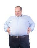 一件蓝色衬衣的愉快的肥胖人 库存图片