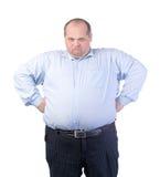 一件蓝色衬衣的愉快的肥胖人 免版税库存图片