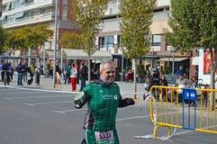一位愉快的马拉松运动员 免版税库存图片