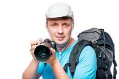 一位摄影师的水平的画象有一台照相机的在手上 库存图片