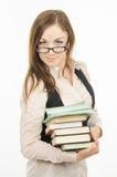 一位老师的画象有课本和笔记本堆的  库存图片