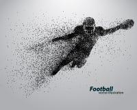 一位足球运动员的剪影从微粒的 橄榄球 美国足球运动员 免版税图库摄影