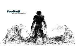 一位足球运动员的剪影从微粒的 橄榄球 美国足球运动员 免版税库存照片