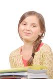 一位11岁的女小学生的画象白色背景的 免版税库存图片