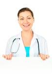 一位医生的画象有一张大白色海报的 库存图片