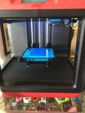 一刹那伪造3D印刷工作蓝色岗亭 库存图片