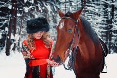 一匹美丽的女孩和英俊的公马,在t的马的画象 图库摄影