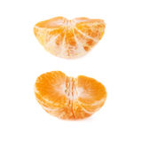 一半新鲜的水多的蜜桔果子被隔绝在白色背景 免版税图库摄影