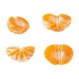 一半新鲜的水多的蜜桔果子被隔绝在白色背景 免版税库存图片