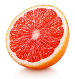 一半粉红色葡萄柚在白色隔绝的柑桔 图库摄影