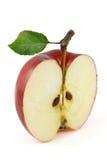 一半红色苹果 图库摄影