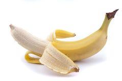 一半被剥皮的香蕉 免版税库存图片